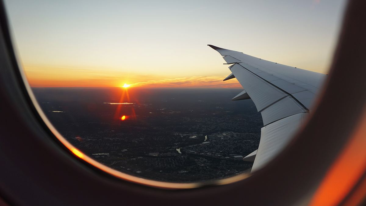 Airplanes Window View Of Sky During Golden Hour Image Free Stock