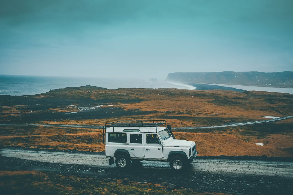 stock photos free  of white Jeep SUV on gray rocky road during daytime
