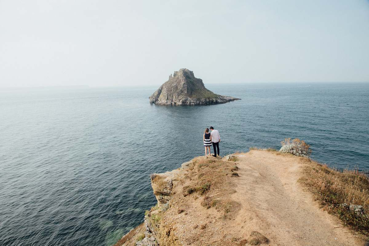 stock photos free  of sea aerial photography of man and woman near cliff water