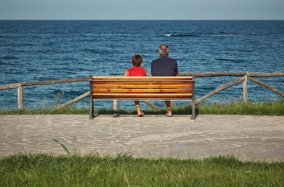 stock photos free  of human two person sitting on bench beside body of water person