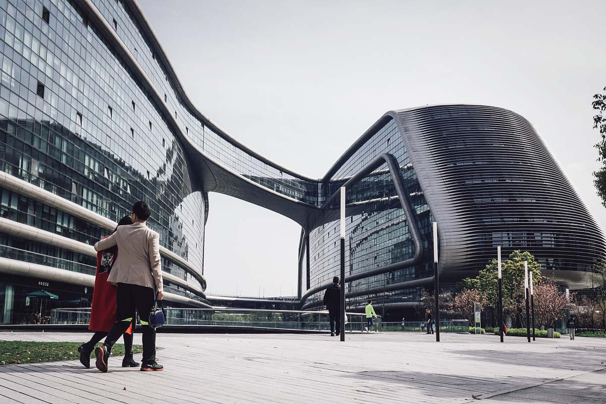 stock photos free  of human architectural photography of glass windows of conjoined building walking