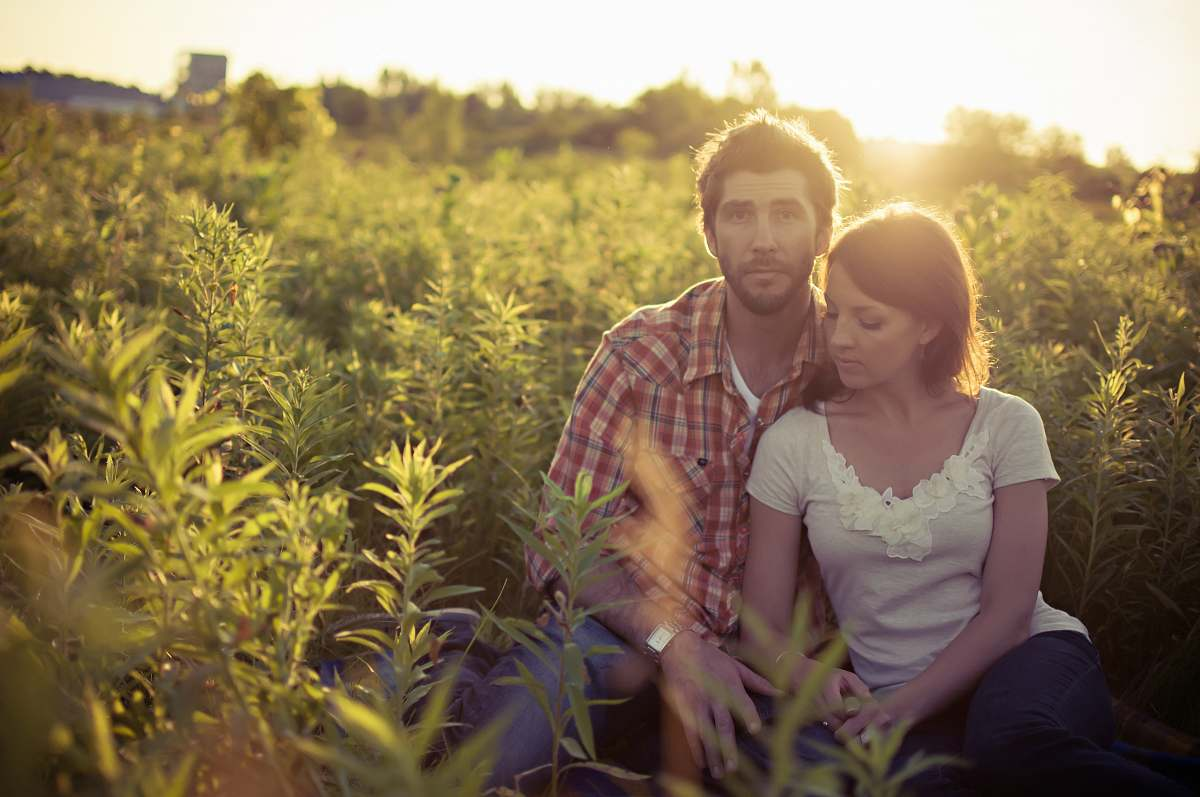 stock photos free  of plant man and woman sitting on grass field at daytime human