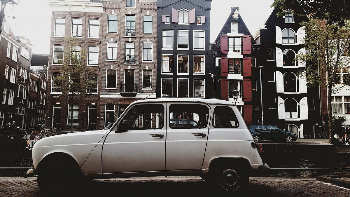 stock photos free  of vehicle white vehicle parked beside concrete buildings transportation
