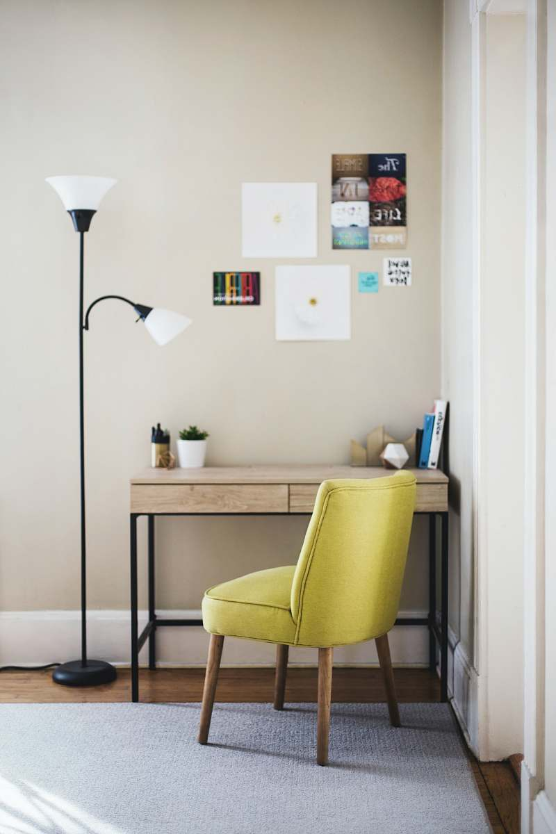 stock photos free  of furniture black 2-light torchiere beside brown wooden-top desk with black steel frame chair