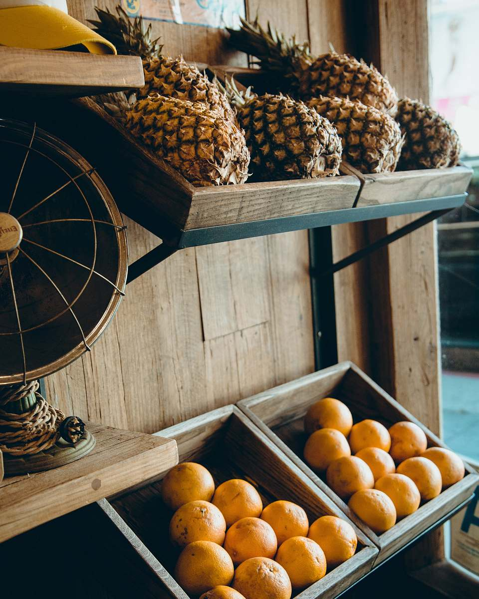 stock photos free  of food pineapple and orange fruits on brown wooden rack orange