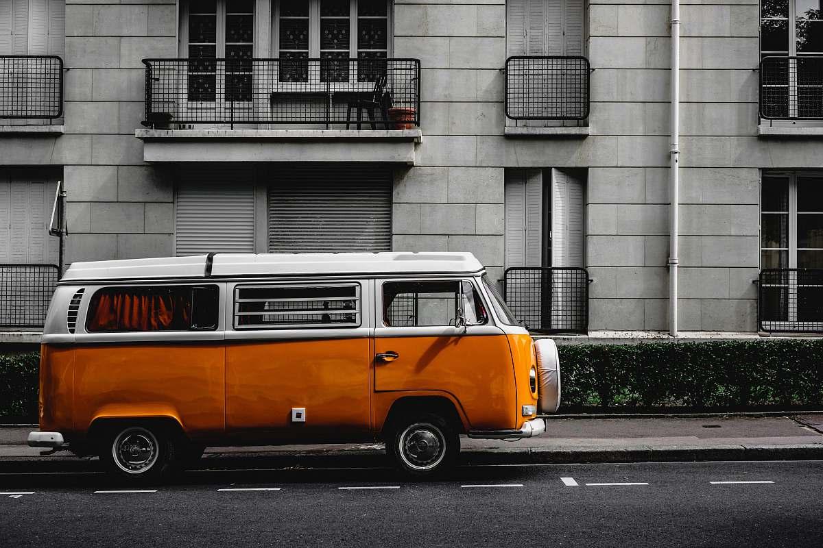 stock photos free  of caravan white and orange Volkswagen Kombi on road transportation