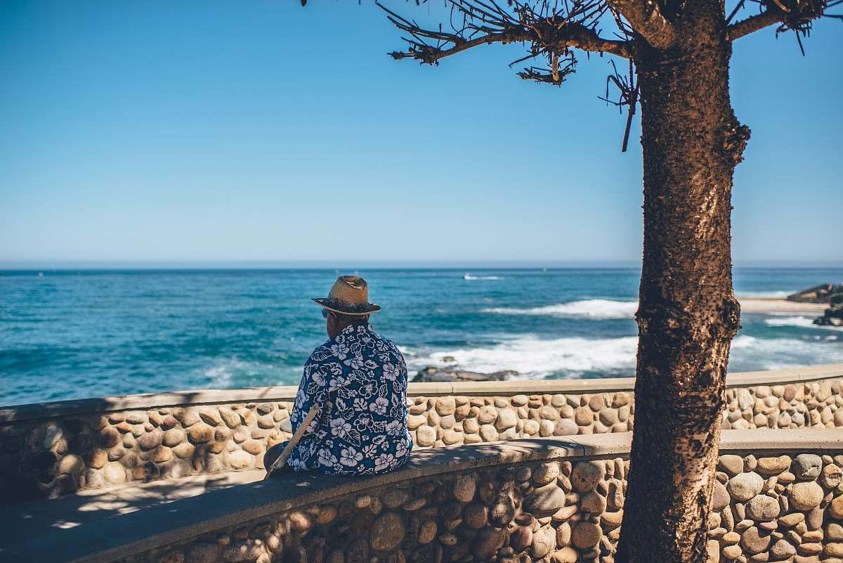 stock photos free  of ocean man sitting facing sea waves