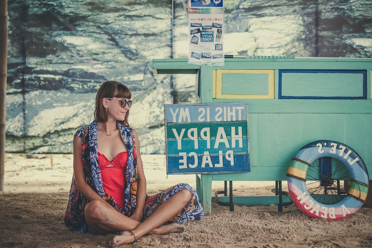 stock photos free  of woman sitting on sand beside of This is My Happy Place signage