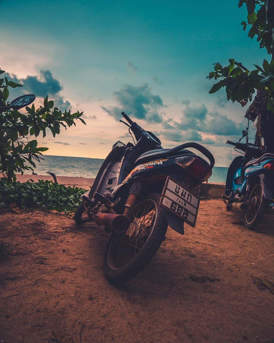 stock photos free  of motorcycle two black motorcycles near ocean wheel