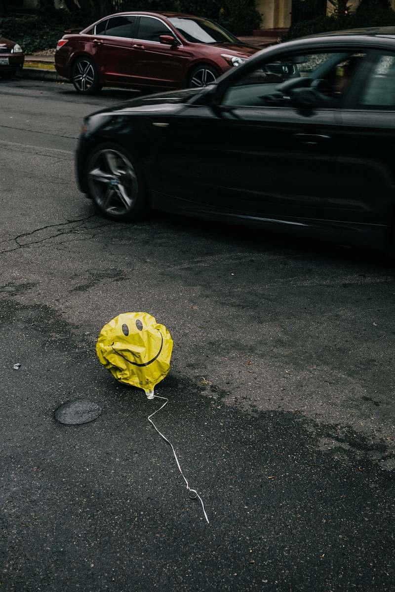 stock photos free  of automobile smiling emoji balloon beside black car during daytime transportation