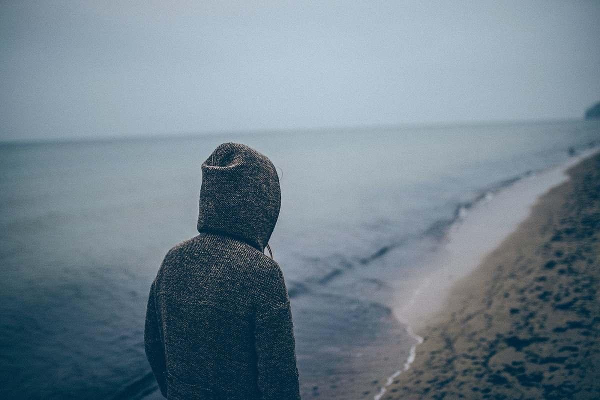 stock photos free  of sea person standing beside seashore sea shore