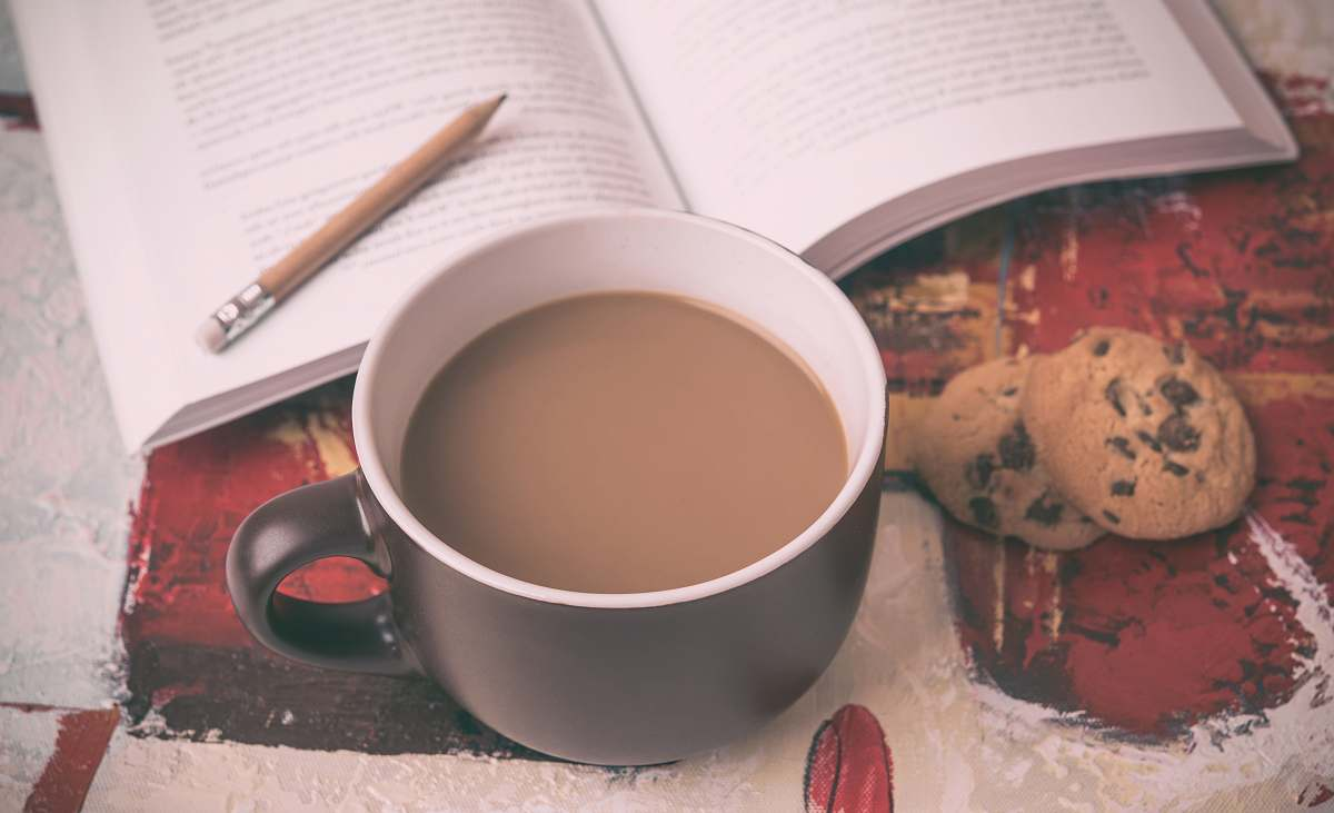 stock photos free  of cup beverage filled mug beside cookie and book food