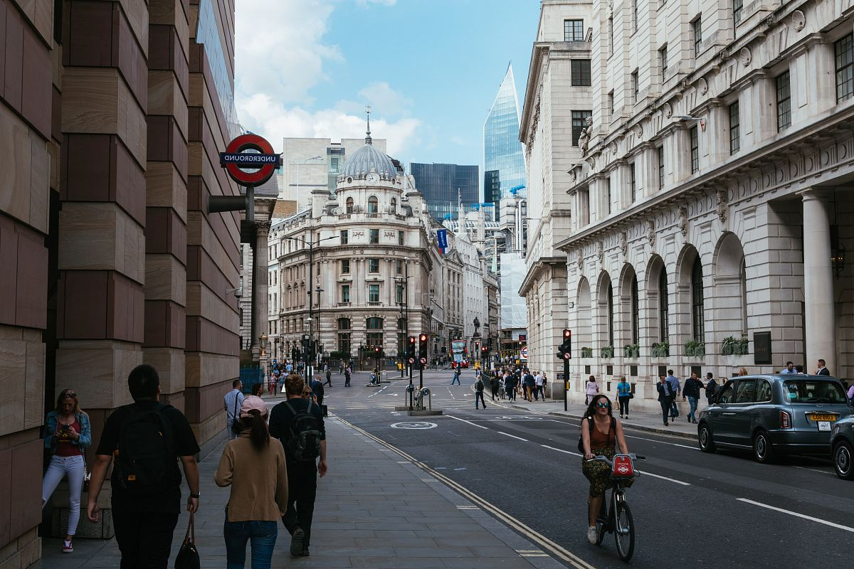 stock photos free  of group of people walking near buildings