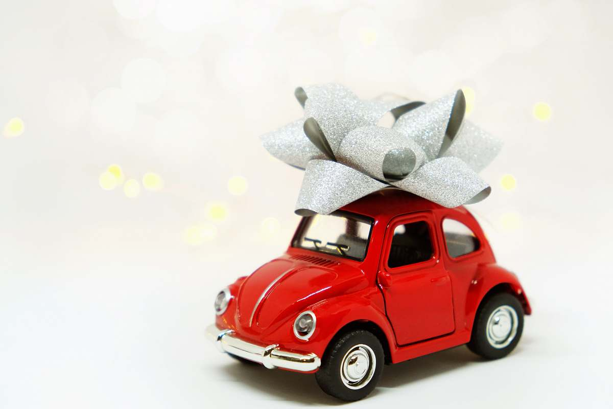 stock photos free  of red red Volkswagen Beetle miniature gift with gray ribbon toy