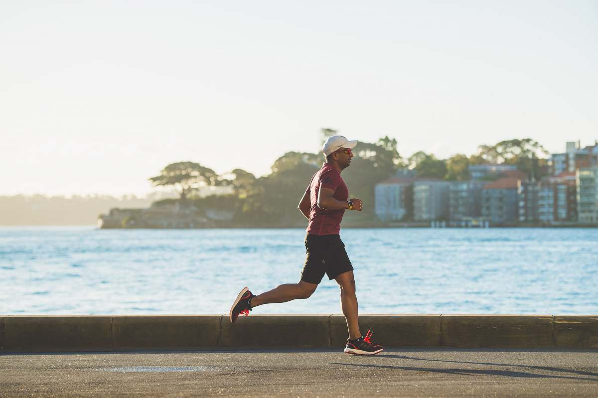 stock photos free  of person man running near sea during daytime sports