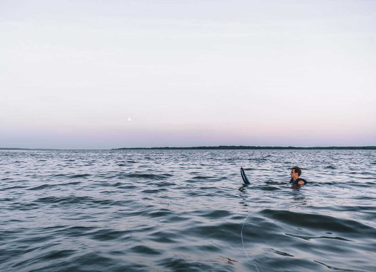 stock photos free  of person man on body of water across horizon sport