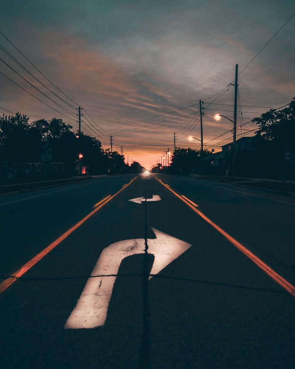 stock photos free  of arrow highway near trees during golden hour dusk