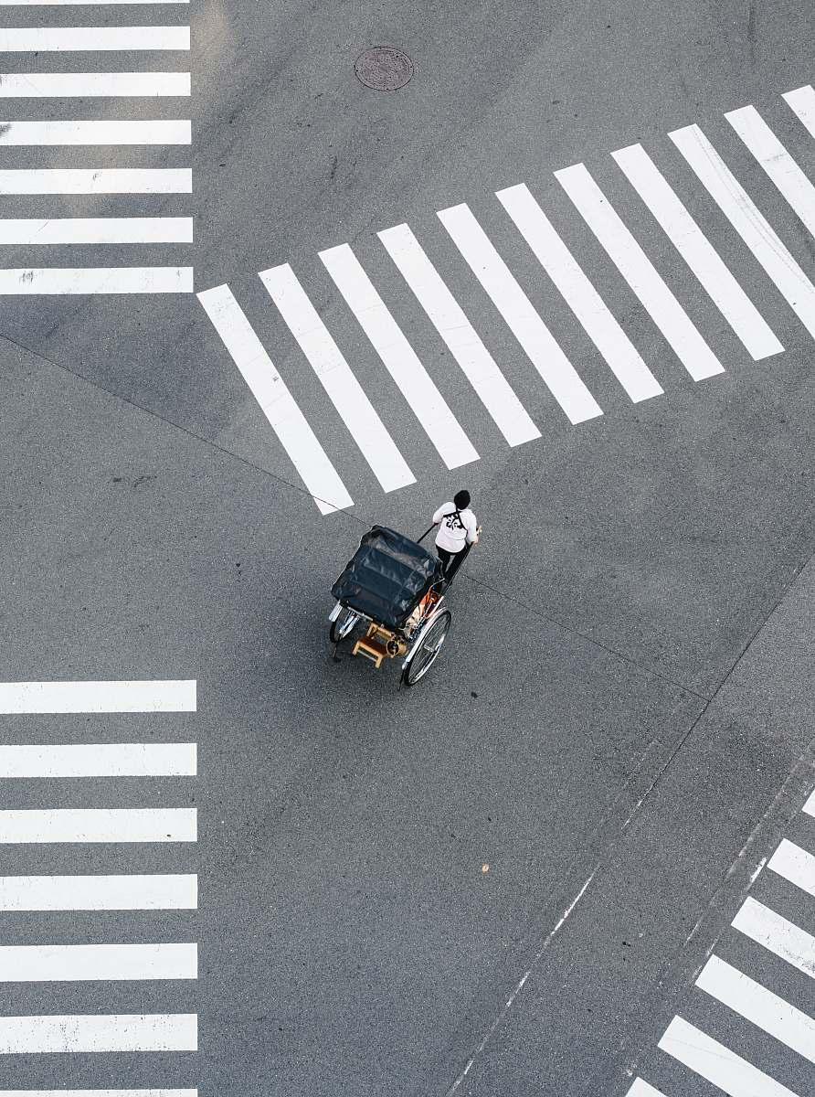 stock photos free  of asphalt man pulling carriage crossing pedestrian tarmac