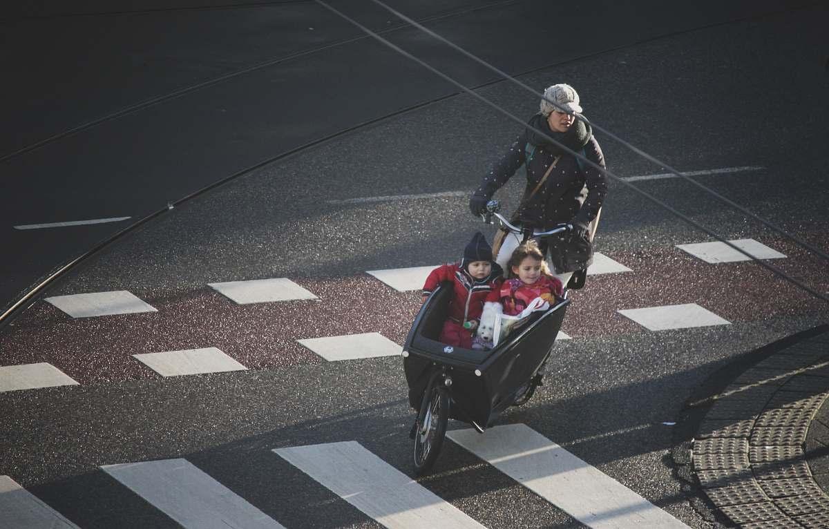 stock photos free  of asphalt woman and two children riding on trike tarmac