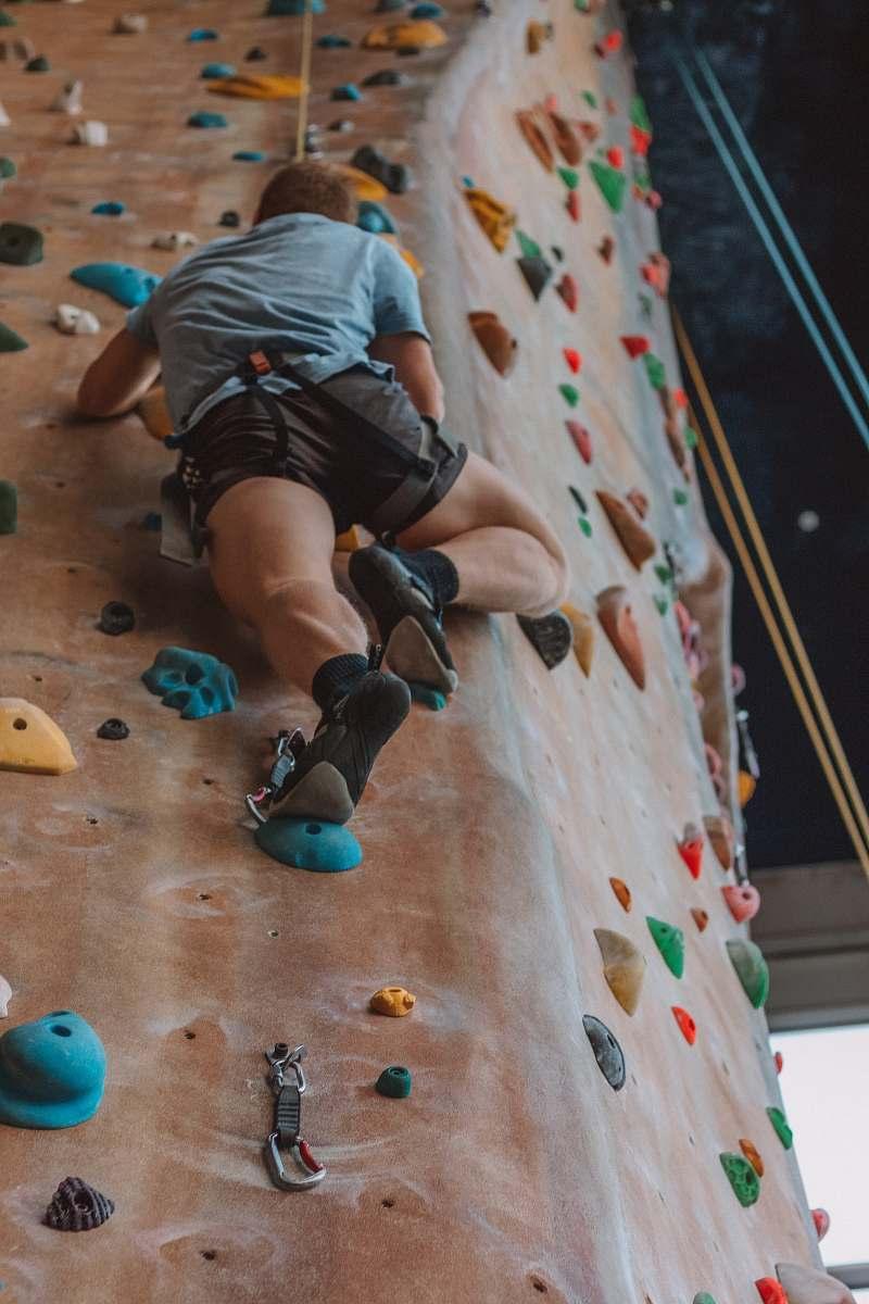 stock photos free  of outdoors man rock climbing inside climbing area at daytime rock climbing