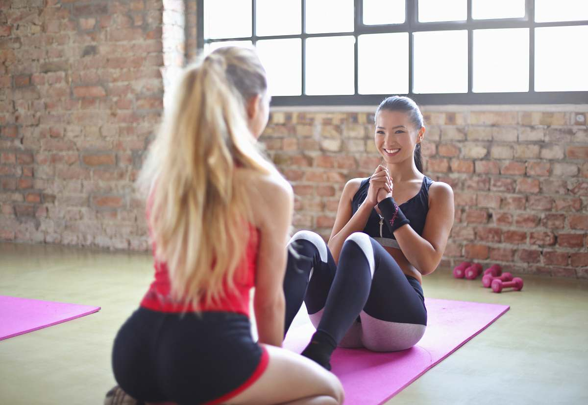 stock photos free  of fitness woman sitting on yoga mat with in front of girl during daytime yoga