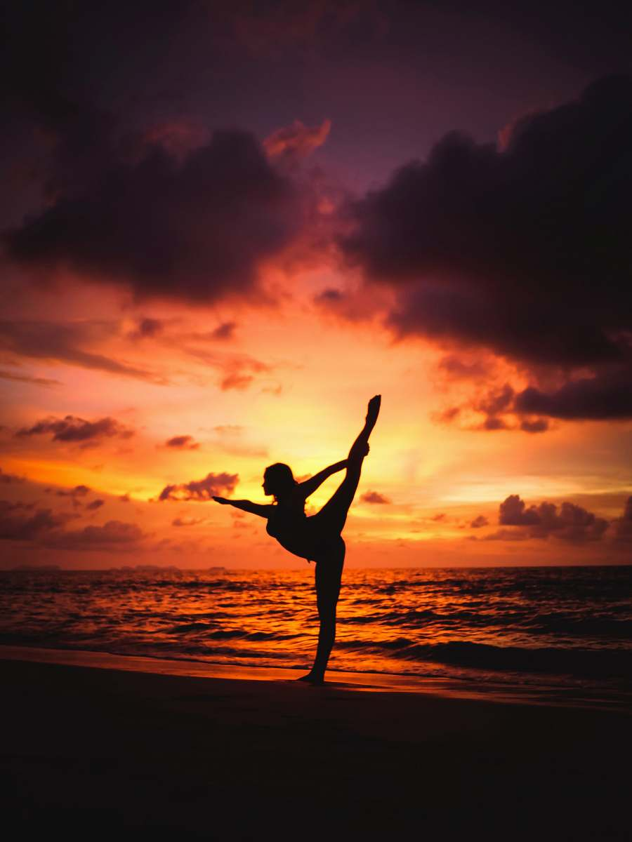 stock photos free  of sport silhouette photography of woman stretching front of sea yoga
