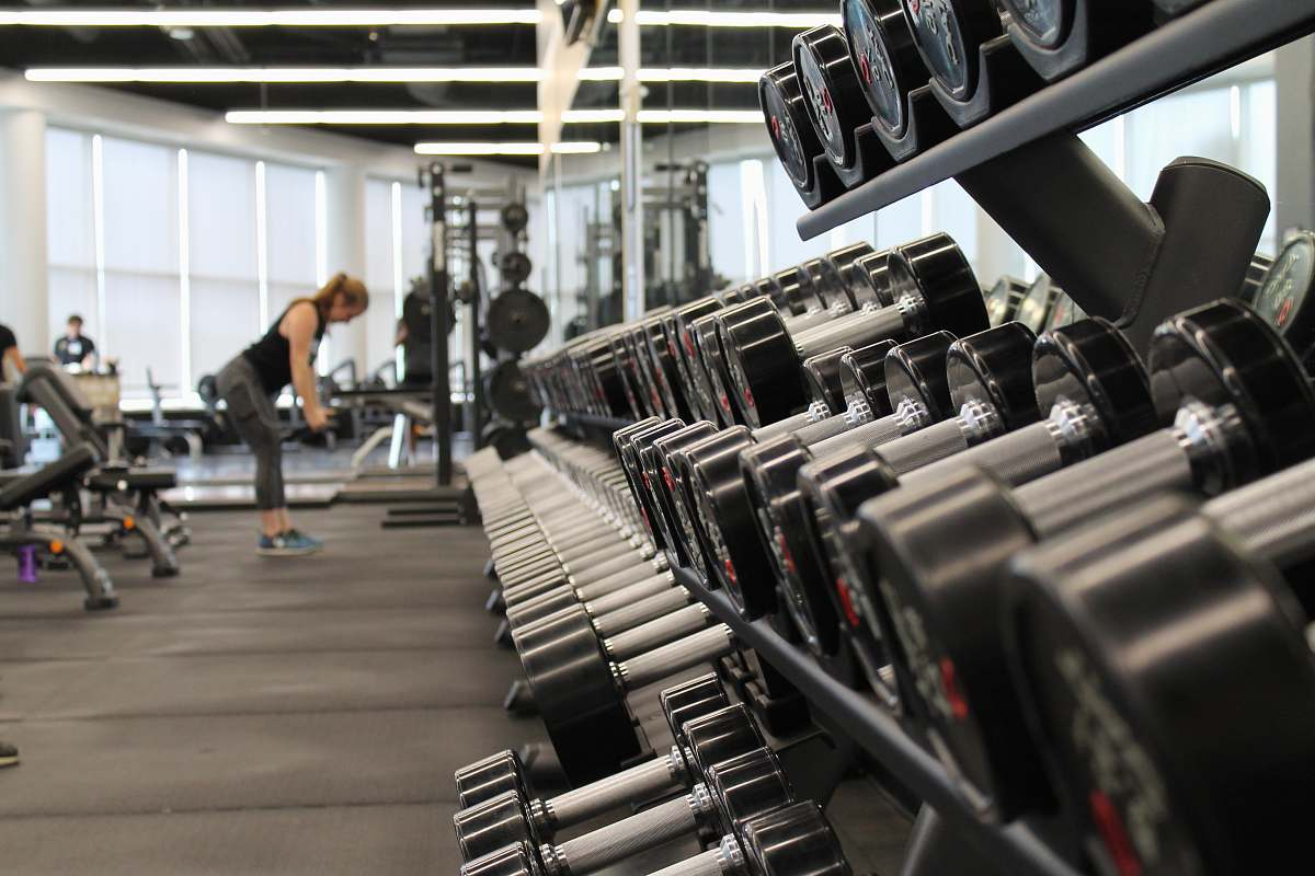 stock photos free  of gym woman standing surrounded by exercise equipment exercise