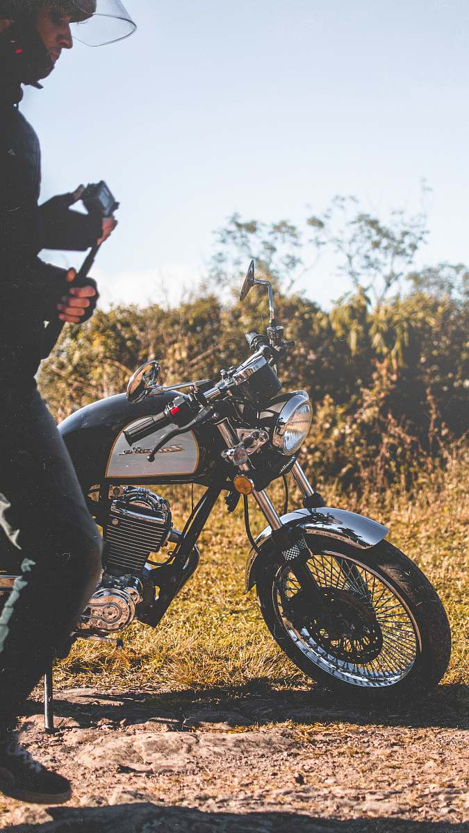 stock photos free  of wheel man beside a black and white motorcycle motorcycle
