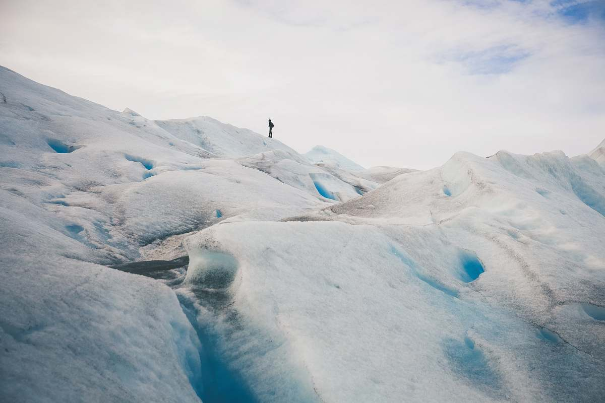 stock photos free  of ice person standing on top of hill under white cloud blue skies glacier