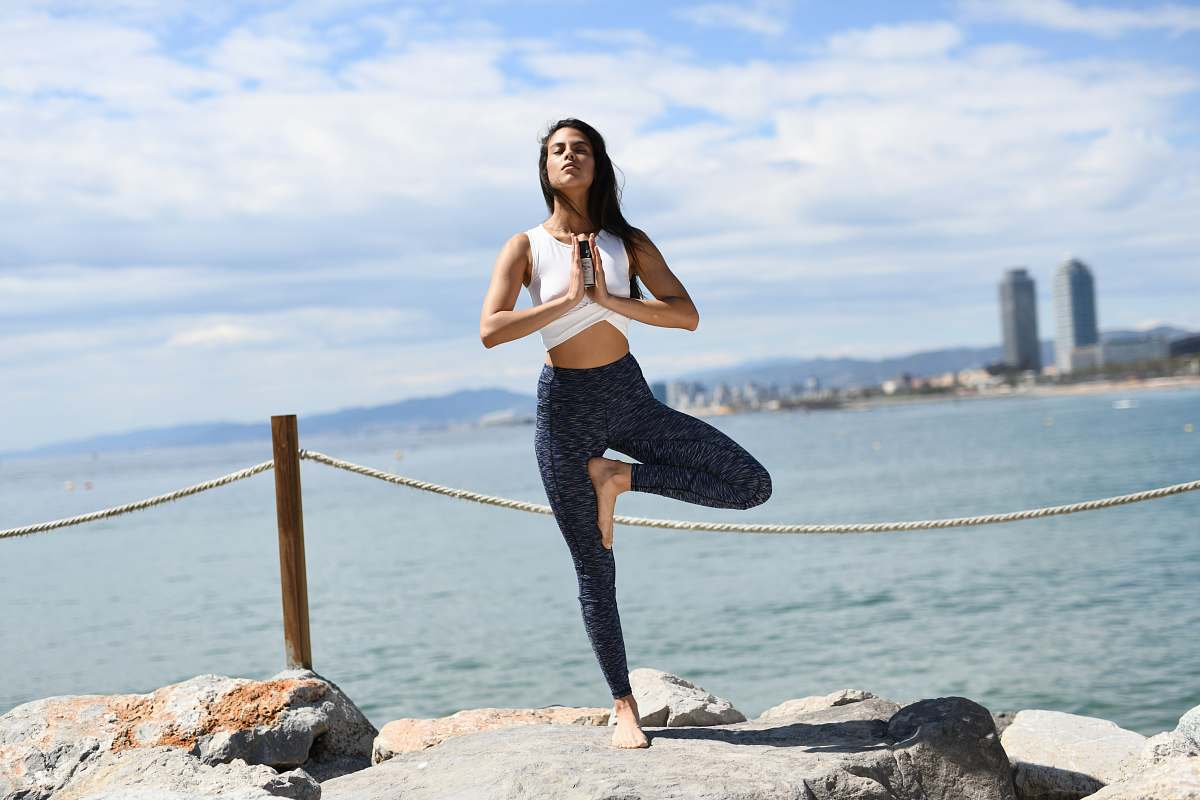 stock photos free  of fitness woman stands and poses near shore exercise