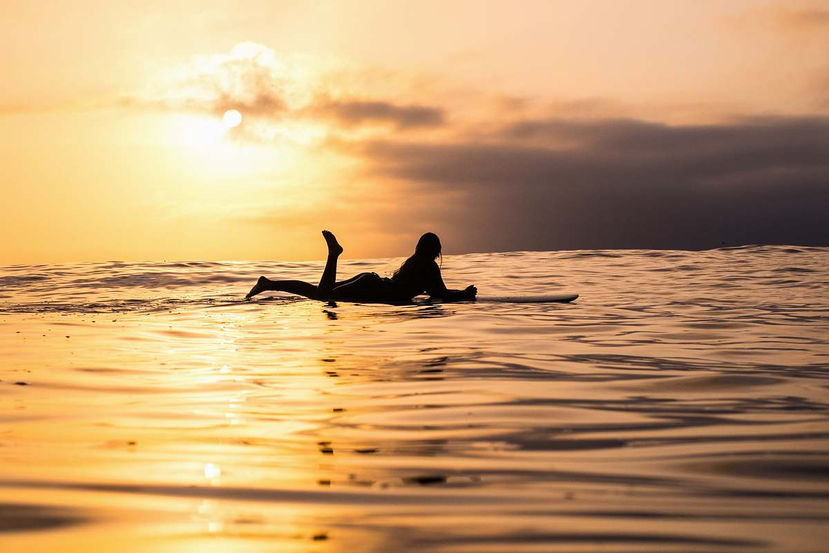 stock photos free  of water silhouette of woman lying on surfboard at the sea surf