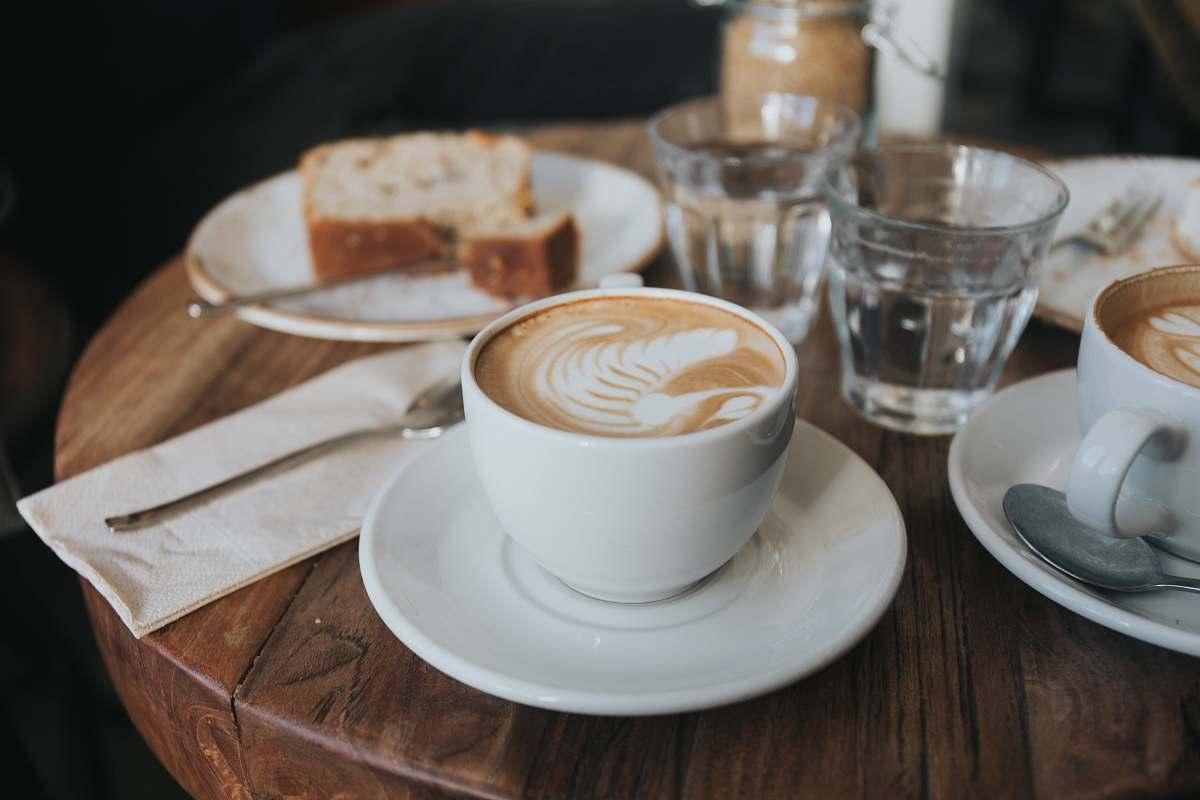 stock photos free  of vienna white ceramic mug on white ceramic saucer on brown wooden table saucer