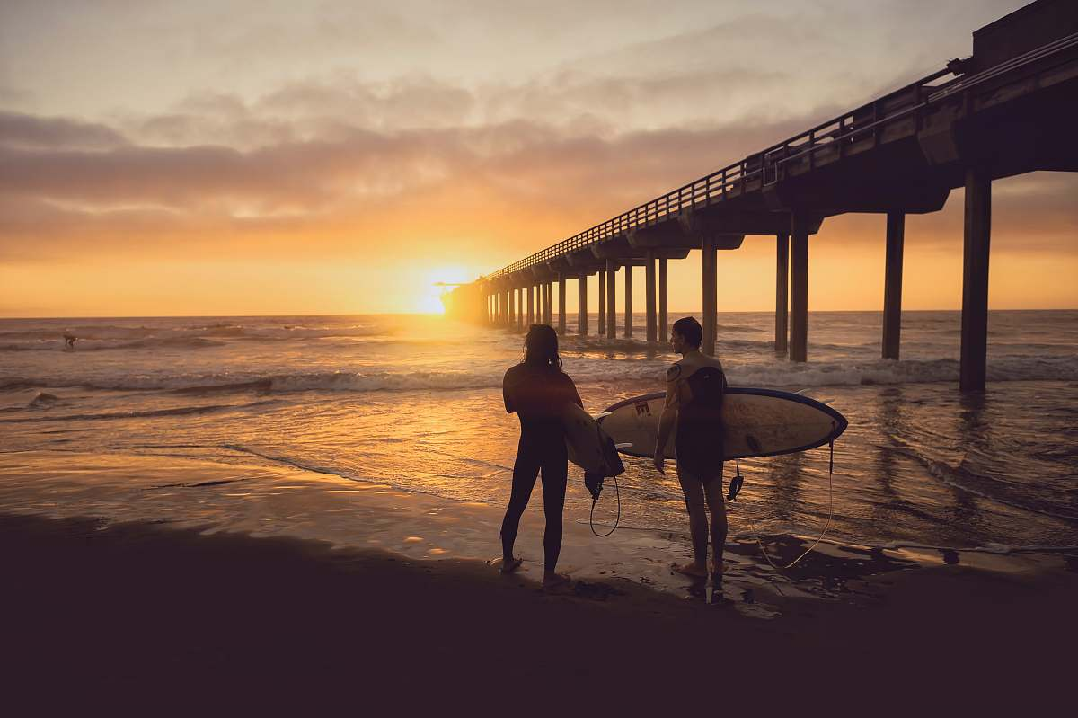 stock photos free  of sea woman carrying surfboard beside person during sunset surfboard