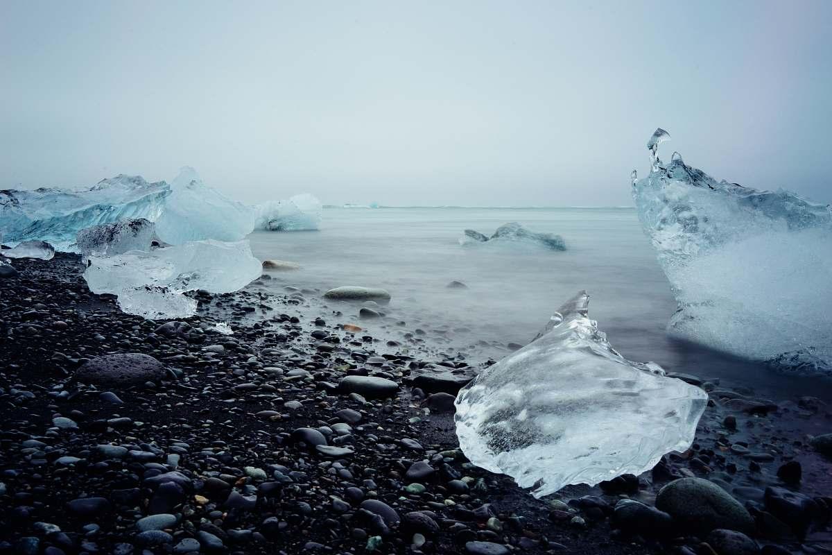 stock photos free  of glacier ice blocks on black stone fragment frozen