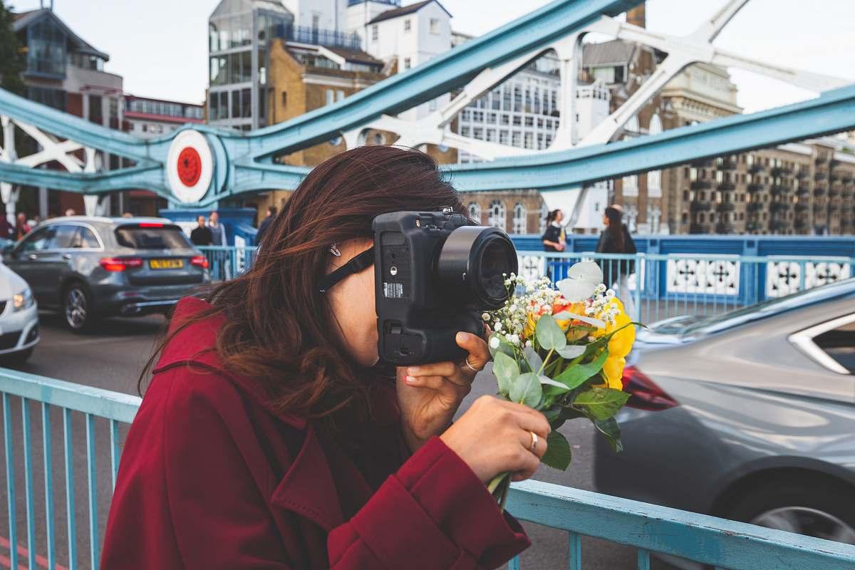 stock photos free  of person woman holding black DSLR camera camera