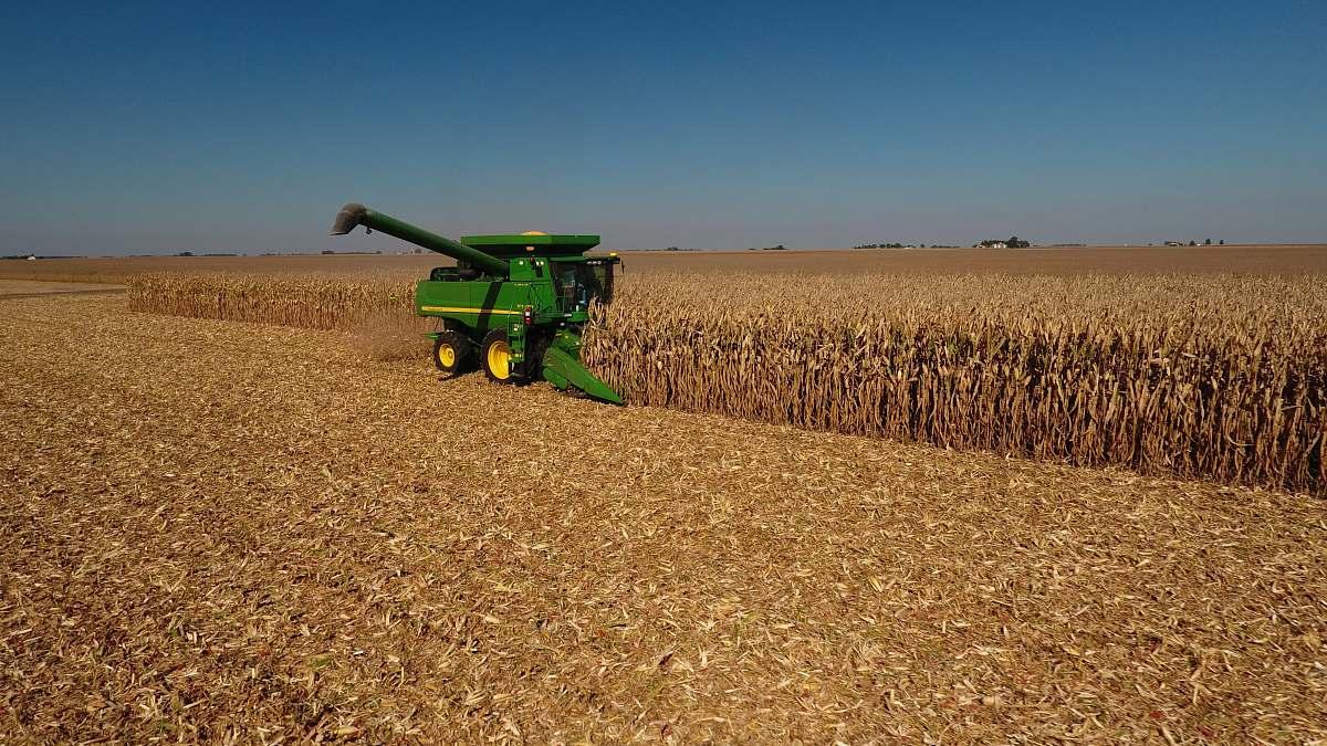 stock photos free  of outdoors John Deere plow beside dried field countryside