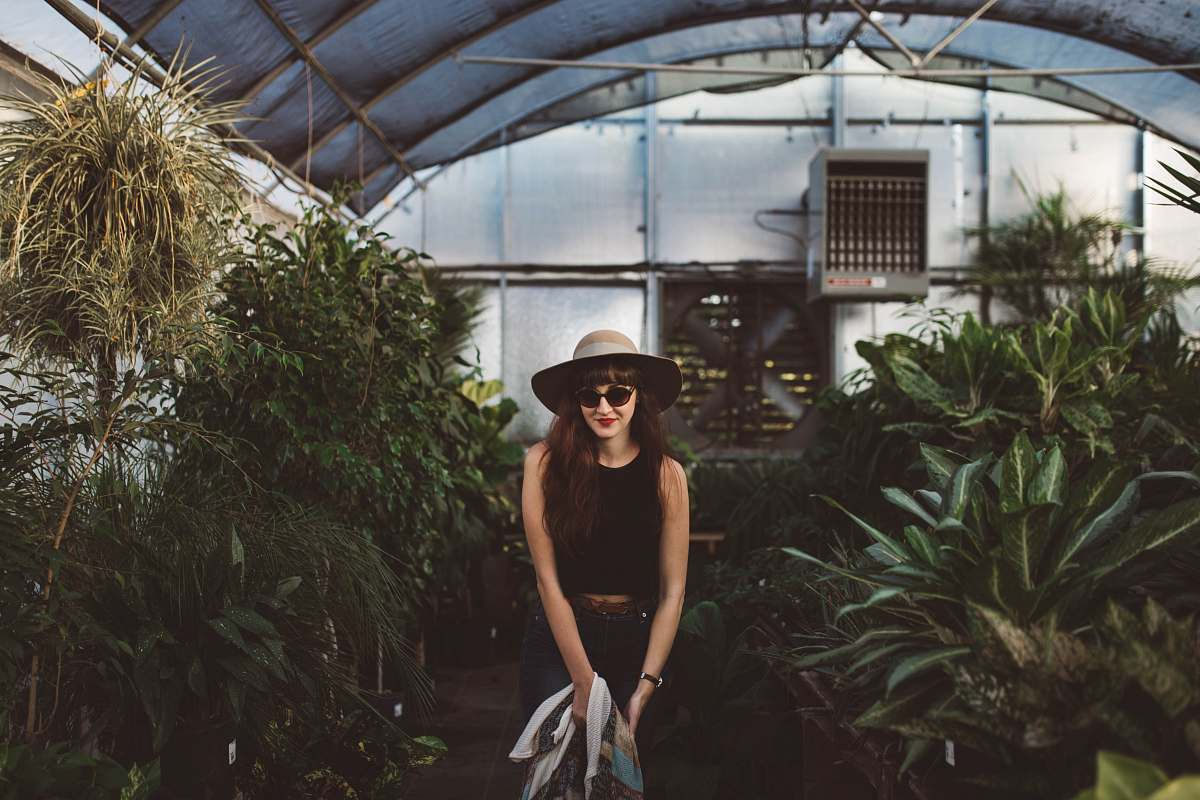 stock photos free  of  woman standing in between plants