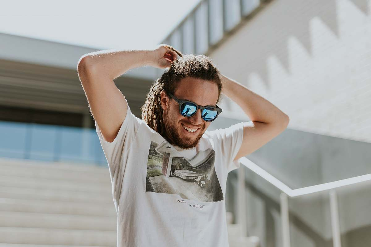stock photos free  of human man tying his hair walking on stairs person