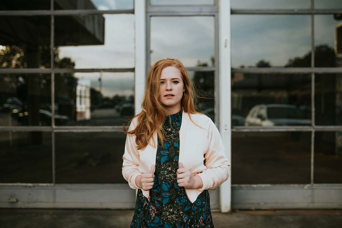stock photos free  of human woman holding her jacket person