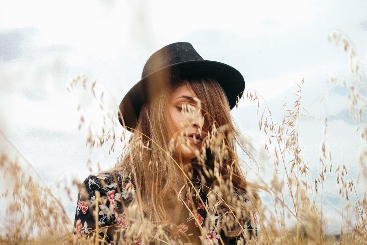 stock photos free  of woman woman wearing black hat near brown grass during daytime girl