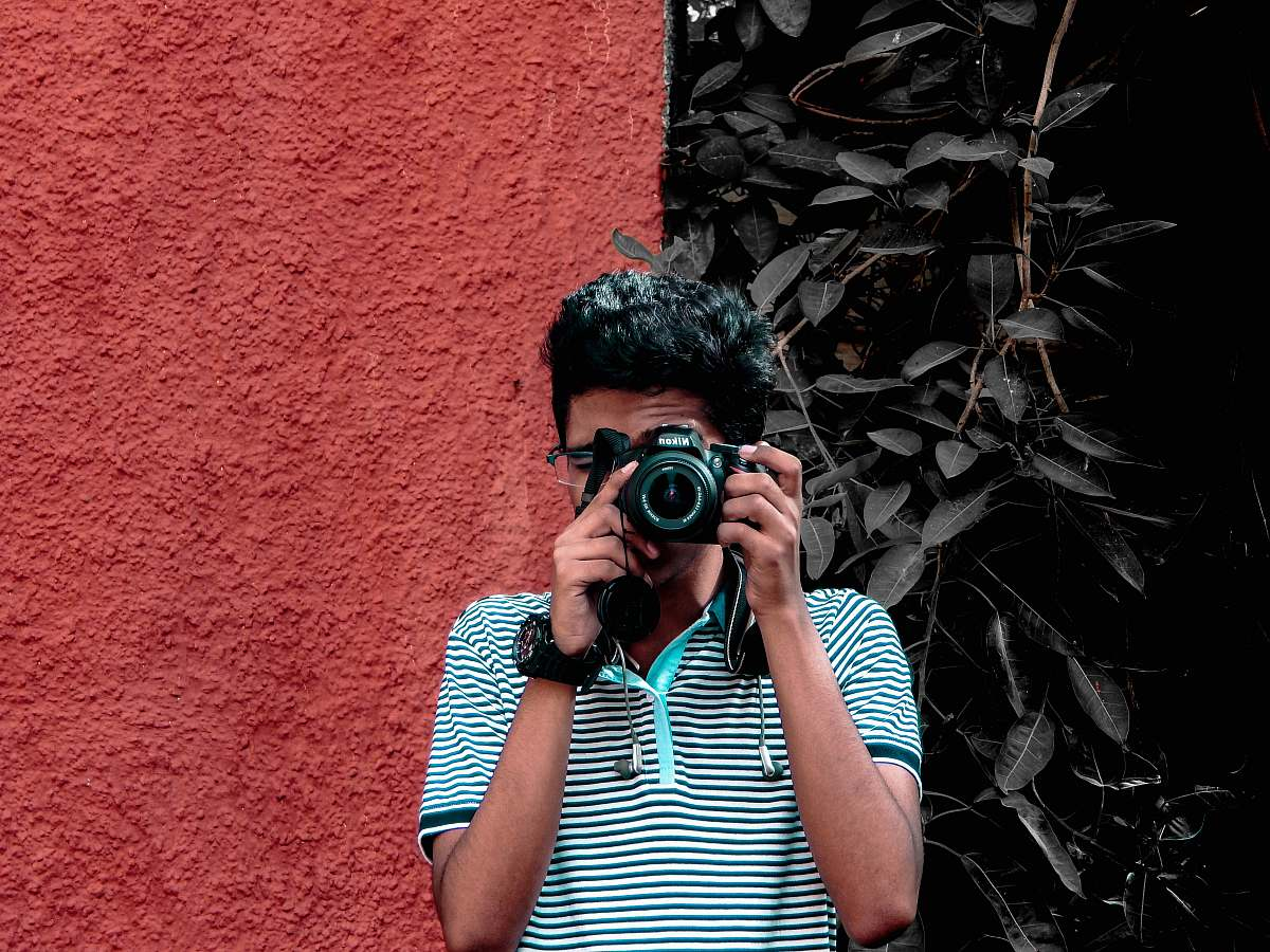 stock photos free  of human man holding camera during daytime camera