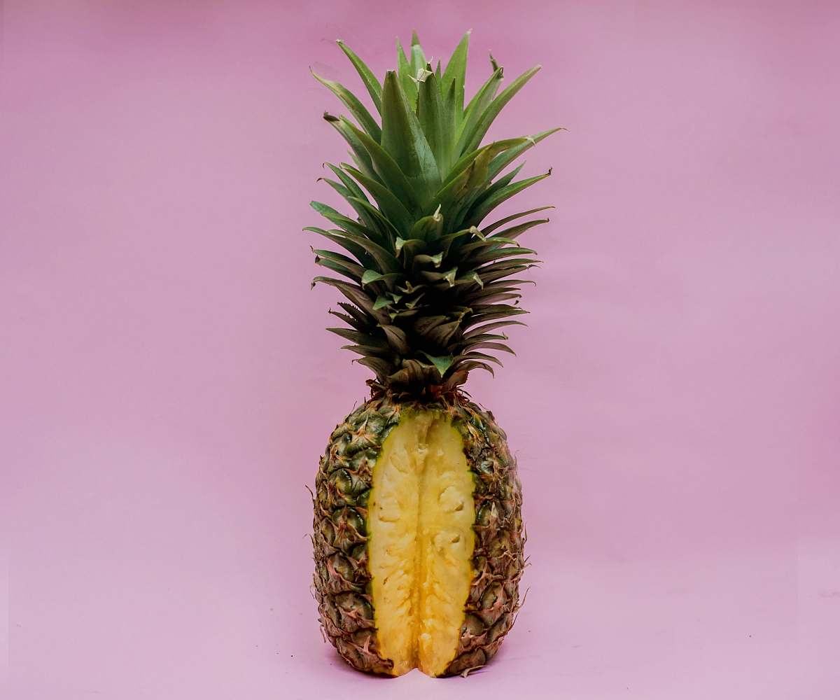 stock photos free  of pineapple pineapple fruit on pink surface food