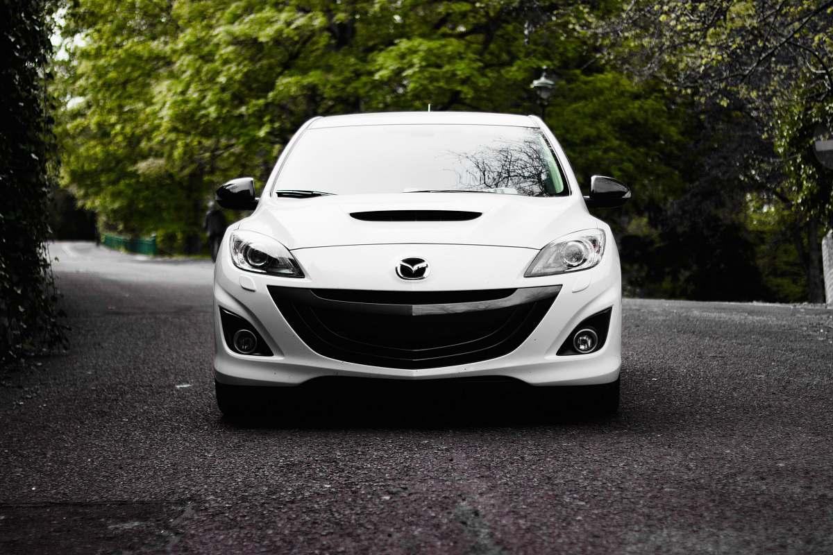 stock photos free  of automobile white Mazda vehicle on road near tree vehicle