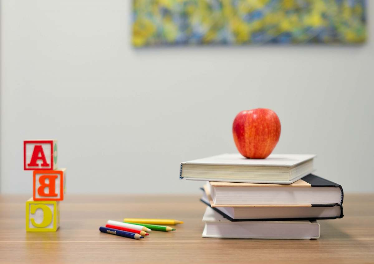 stock photos free  of book red apple fruit on four pyle books education