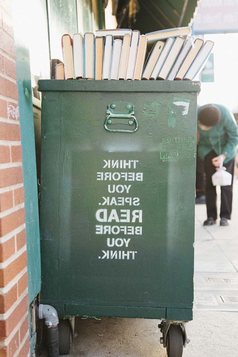 stock photos free  of human books over green trolley bin quote