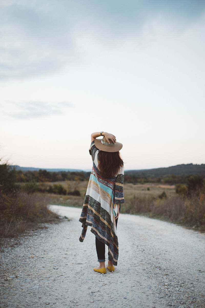 stock photos free  of people standing woman holding her hat at the middle of the road during day woman