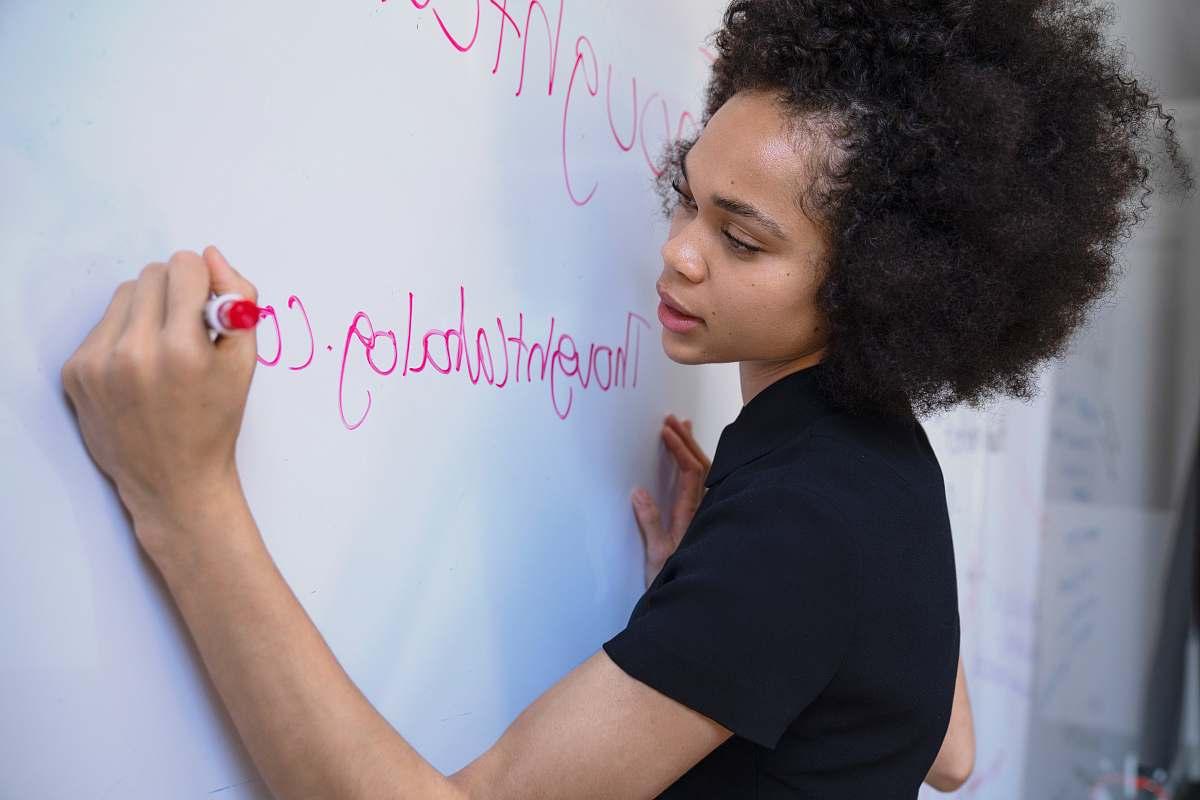 stock photos free  of people woman writing on dry erase board human