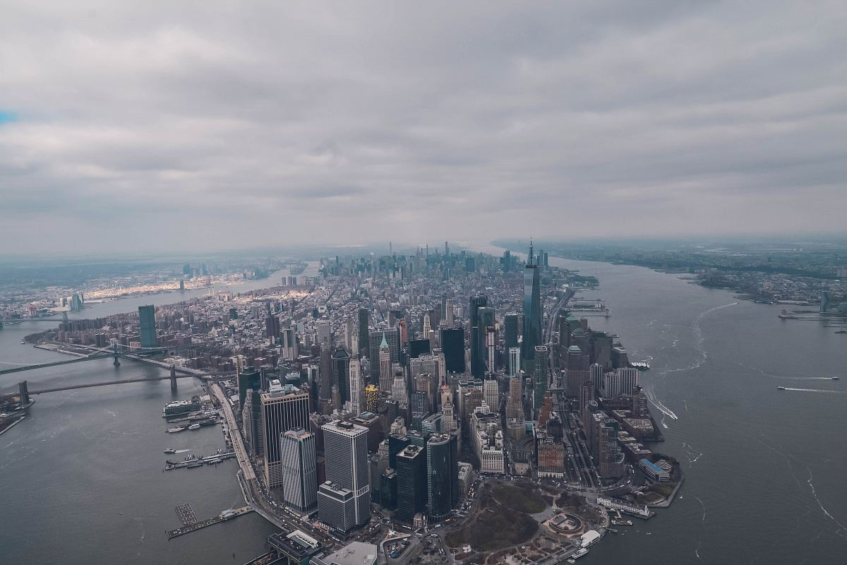 stock photos free  of aerial photo of high rise buildings surrounded by sea during daytime
