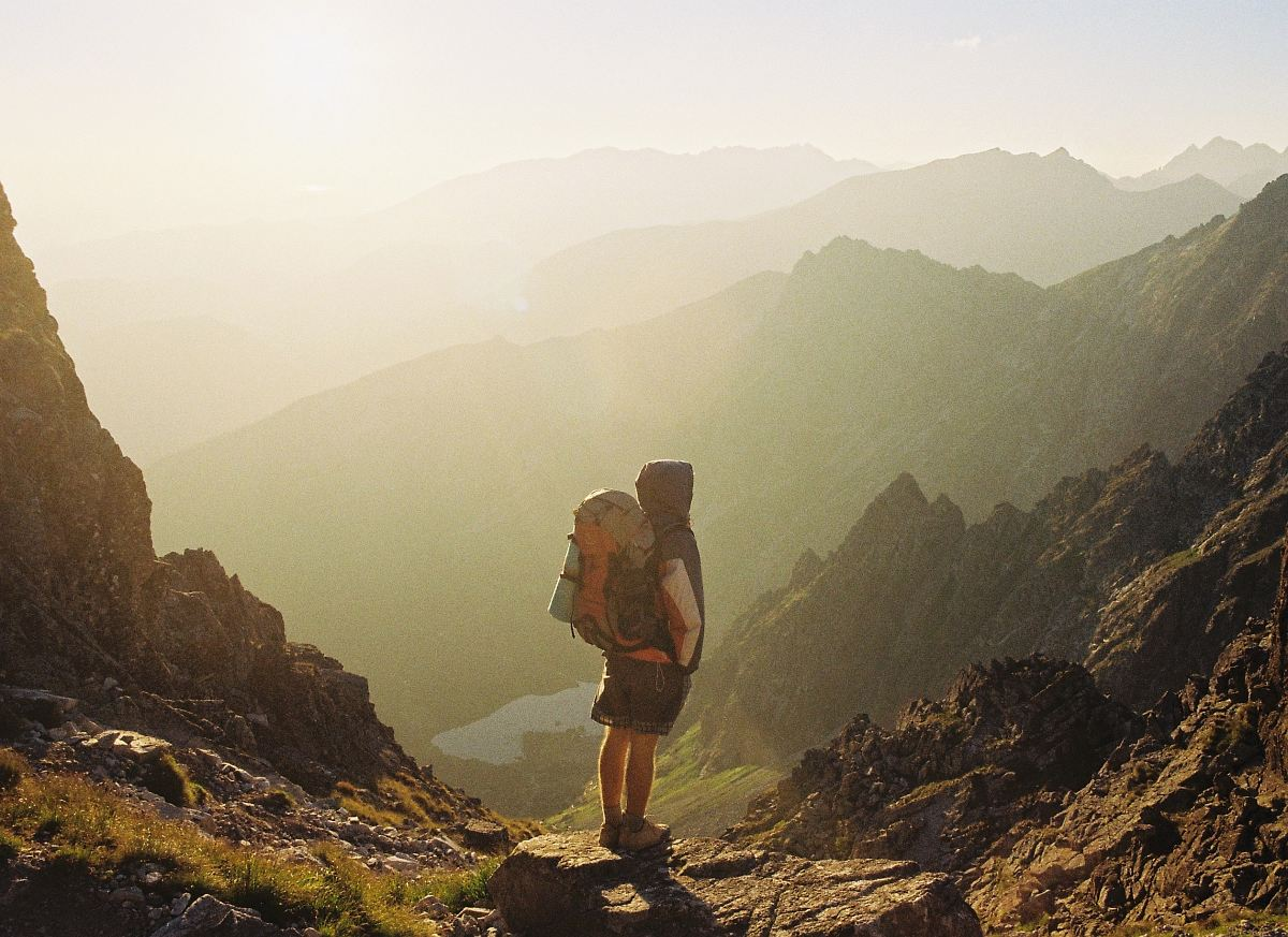 stock photos free  of climber standing on rock near overlooking view of mountain at daytime