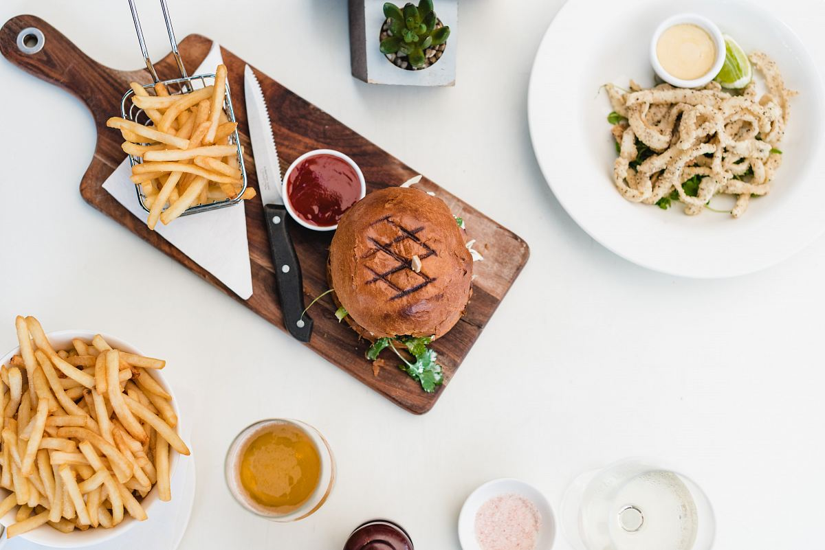 stock photos free  of fries and meat on chopping board